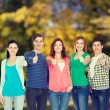 Smiling students showing thumbs up — Stock Photo #66819267