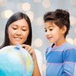 Mother and daughter with globe — Stock Photo #66819487