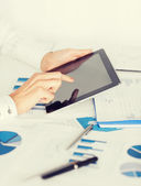 Woman with tablet pc and  papers — Stock Photo