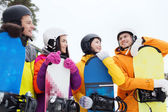 Friends in helmets with snowboards — Stock Photo