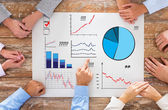 Business team with charts at table — Stock Photo