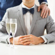 Male gay couple with champagne — Stock Photo #66820593