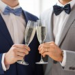 Male gay couple with champagne — Stock Photo #66820621
