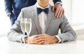 Male gay couple with champagne — Stock Photo