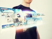 Man pressing button on virtual screen — Stock Photo