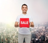 Man with sale sign up — Stock Photo