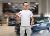 Smiling man  pointing finger on himself — Stock Photo