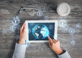 Hands with tablet pc and network — Stock Photo