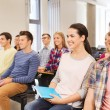 Group of smiling students in lecture hall — Stock Photo #67230983