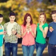 Smiling students with smartphones — Stock Photo #67231275