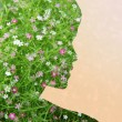 Woman silhouette with green floral pattern — Stock Photo #67231311
