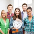 Group of students at school with clock — Stock Photo #67231451