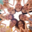 Group of smiling teenagers showing victory sign — Stock Photo #67231459