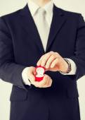 Man with gift box and wedding ring — Stock Photo