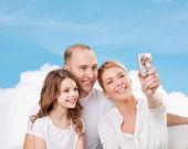 Happy family with camera at home — Stock Photo