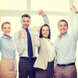 Business team celebrating victory in office — Stock Photo #67628159