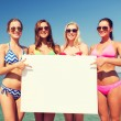 Group of smiling women with blank board on beach — Stock Photo #67629819