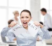 Serious businesswoman tearing contract — Stock Photo