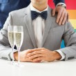 Close up of male gay couple with champagne glasses — Stock Photo #67630753