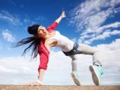Beautiful dancing girl in movement — Stock Photo