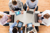 Business team with laptop and tablet pc — Stock Photo