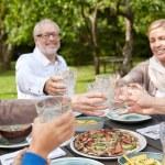 Happy family having dinner in summer garden — Stock Photo #67965065