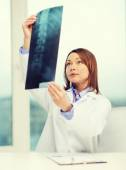 Concentrated doctor looking at x-ray — Stock Photo