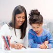 Happy mother and daughter drawing with pencils — Stock Photo #67992773