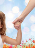 Close up of woman and little girl holding hands — Stock Photo