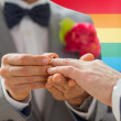 Close up of male gay couple hands and wedding ring — Stock Photo #68266541