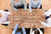 Close up of business team sitting at table — Stock Photo