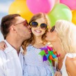 Family with colorful balloons — Stock Photo #68383739