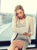Worried woman with documents — Stock Photo