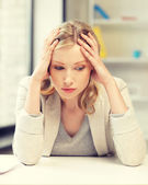 Unhappy woman in office — Stock Photo