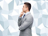 Thinking businessman in suit making decision — Stock Photo