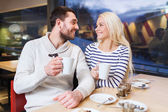 Happy couple meeting and drinking tea or coffee — Stock Photo