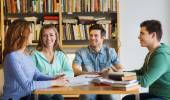 Students with books preparing to exam in library — Stock Photo