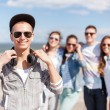 Teenage boy with sunglasses and friends outside — Stock Photo #68708809