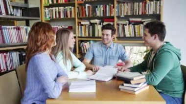 Students with books preparing to exam in library — Stock Video