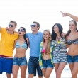 Group of happy friends walking along beach — Stock Photo #68959717