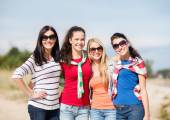 Happy teenage girls or young women on beach — Stock Photo