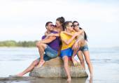 Happy friends on summer beach — Stock Photo