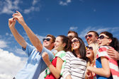 Group of friends taking selfie with cell phone — Stock Photo