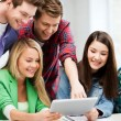 Students looking at tablet pc in lecture at school — Stock Photo #69113013