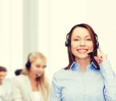 Friendly female helpline operator at office — Stock Photo