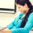 Happy woman with big notepad — Stock Photo #69305713