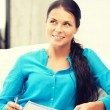 Happy woman with big notepad — Stock Photo #69305881