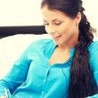 Happy woman with big notepad — Stock Photo #69305885