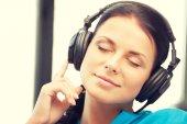 Happy teenage girl in big headphones — Stock fotografie