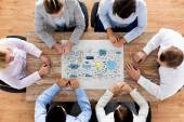 Business team with scheme meeting at office — Stock Photo